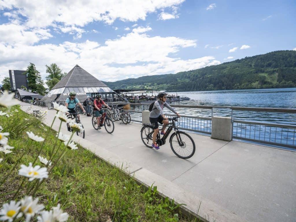 Biking around Lake Millstatt - past the floating pyramid in Millstatt