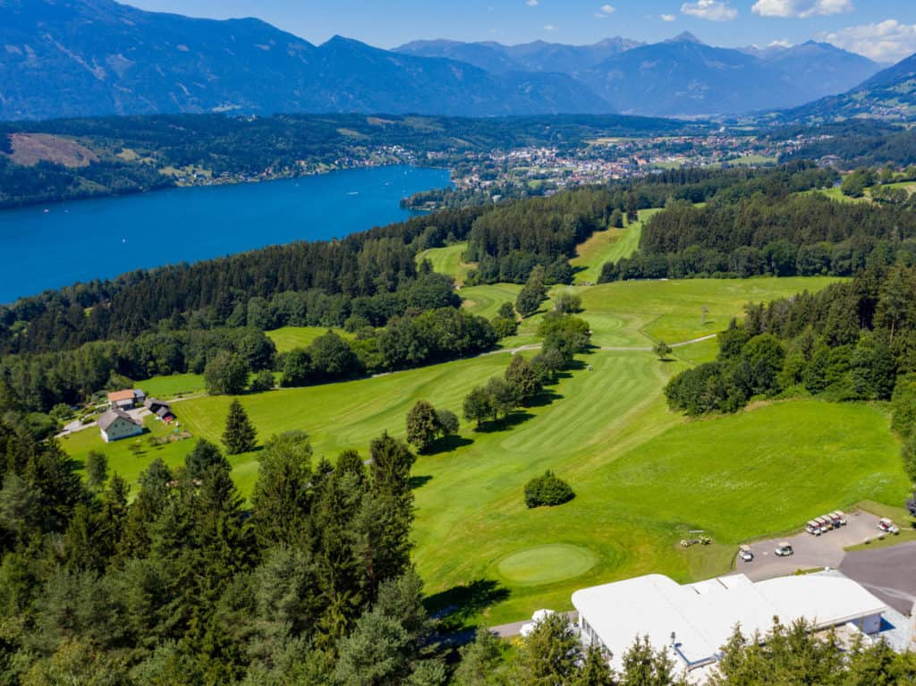 Golf course on sunny plateau with the Millstätter See