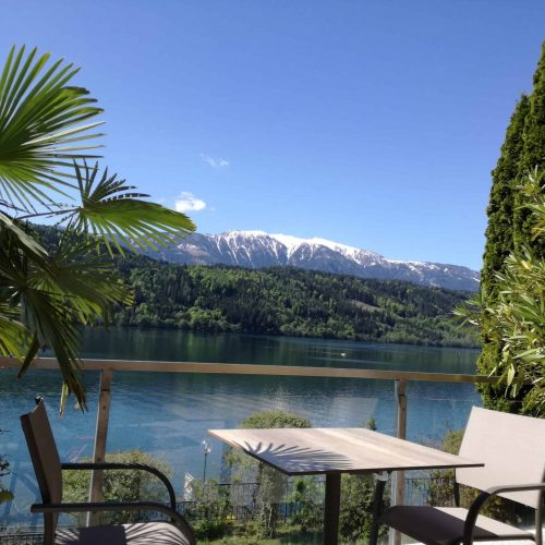 Terrace with view to Nocky Mountains and lake